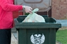 Place the food waste from your caddy into your brown-lidded bin