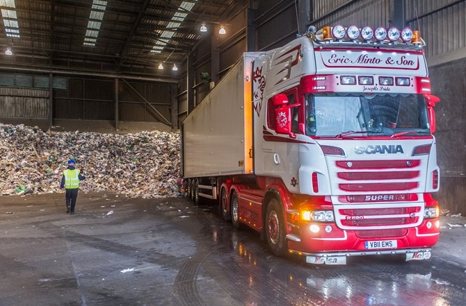 Dry Mixed Recycling lorries tip their contents into the tipping hall at the Materials Recovery Facility (MRF)