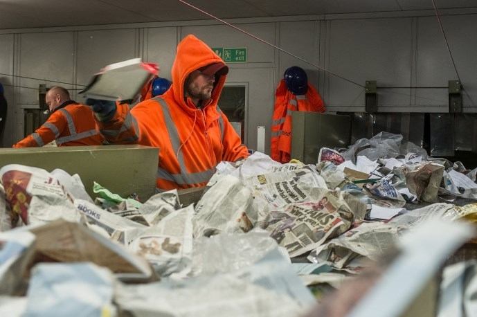 Machines are used to sort much of the material, but large cardboard and contamination is removed by hand