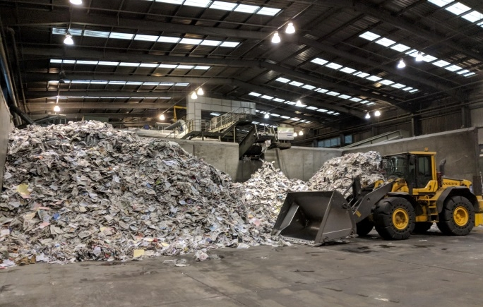 Paper is the last to be removed and drops off the picking line belt. From here it is transported loose to the recycling market
