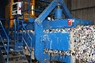 The baling machine compacts sorted materials to prepare it for transportation to the recycling market