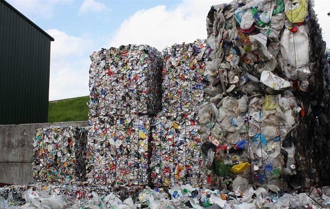 Bales of aluminium cans, steel cans and rigid plastic containers awaiting transportation